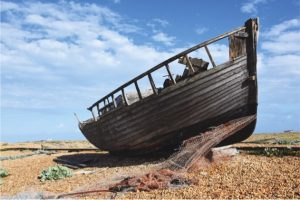 wooden boat on dunes