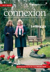 front cover of magazine, showing two women walking together